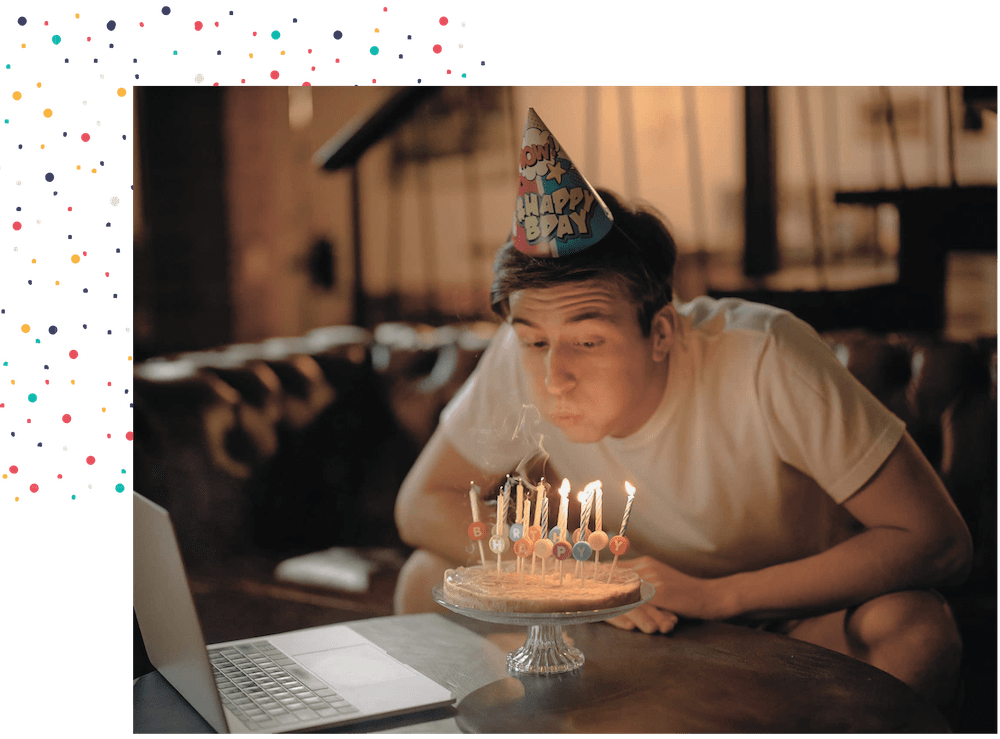 Teen with special needs blowing out his birthday candles - virtual programs for special needs